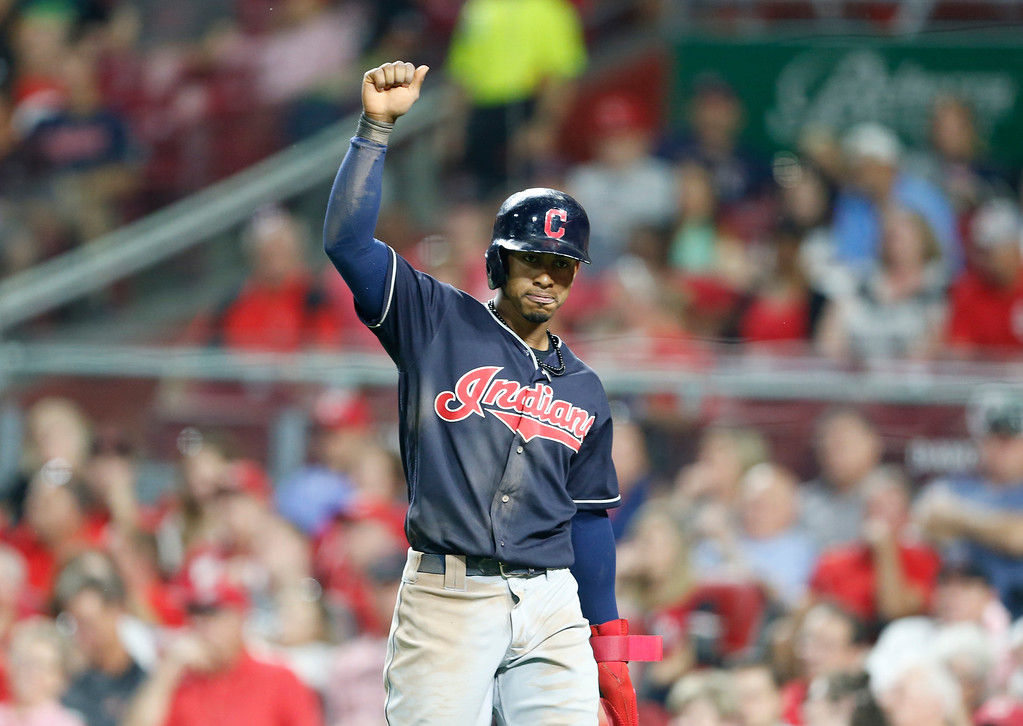 . Cleveland Indians\' Francisco Lindor reacts after scoring on a single by Melky Cabrera, off Cincinnati Reds relief pitcher Amir Garrett during the sixth inning of a baseball game, Monday, Aug. 13, 2018, in Cincinnati. (AP Photo/Gary Landers)