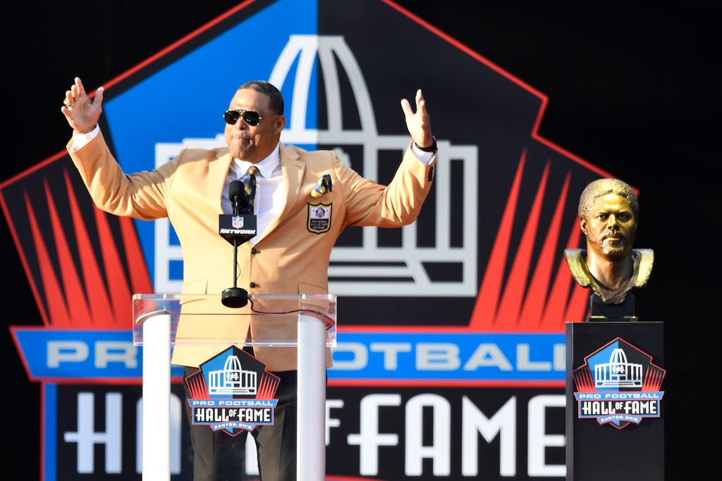 . Former NFL player Robert Brazile delivers his speech during inductions at the Pro Football Hall of Fame on Saturday, Aug. 4, 2018, in Canton, Ohio. (AP Photo/David Richard)