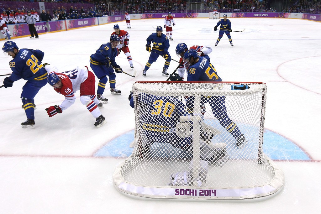 . SOCHI, RUSSIA - FEBRUARY 12:  Jaromir Jagr #68 of Czech Republic scores a goal in the second period against Henrik Lundqvist #30 of Sweden during the Men\'s Ice Hockey Preliminary Round Group C game on day five of the Sochi 2014 Winter Olympics at Bolshoy Ice Dome on February 12, 2014 in Sochi, Russia.  (Photo by Bruce Bennett/Getty Images)