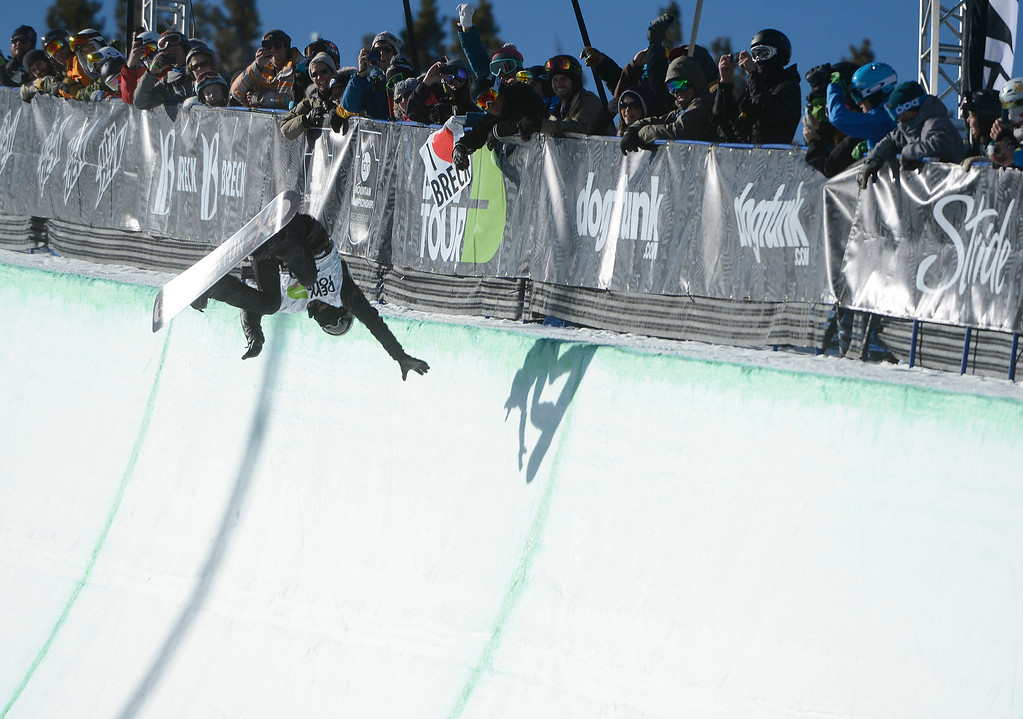 . Pro Snowboarder, Shaun White, reaches out for the wall of the Breckenridge superpipe moments before crashing on his first run of the Dew Tour Ion Mountain superpipe championship finals at Breckenridge Saturday afternoon, December 14, 2013. White recovered on his second run to take second place with a score of 90.40. (Photo By Andy Cross/The Denver Post)