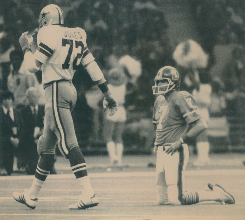 ". The Cowboys defensive team dominated most of Super Bowl XII, forcing 8 turnovers and allowing only 8 pass completions by the Broncos for just 61 yards. Two of those interceptions led to 10 first-quarter points. Denver lost 27-10.  Too Tall Strikes Again--Denver quarterback Craig Morton rests briefly on his knees after being sacked by Dallas defensive end Ed ""Too Tall\' Jones (72) who walks away following the play. The Cowboys defense got to Morton several times during their Super Bowl XII meeting. 1978  Denver Post"