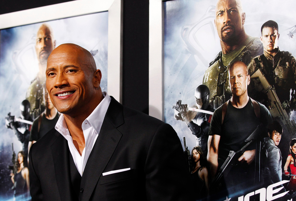 ". Cast member Dwayne Johnson poses at the premiere of ""G.I. Joe: Retaliation\"" in Hollywood, California March 28, 2013. The movie opens in the U.S. on March 28.   REUTERS/Mario Anzuoni"