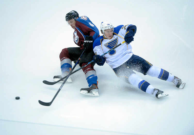 . Colorado defenseman Erik Johnson (6) got tangled up with St. Louis wing T.J. Oshie (74) in the second period. The St. Louis Blues defeated the Colorado Avalanche 2-1 at the Pepsi Center Saturday afternoon, March 8, 2014 in Denver, Colorado. (Photo by Karl Gehring/The Denver Post)