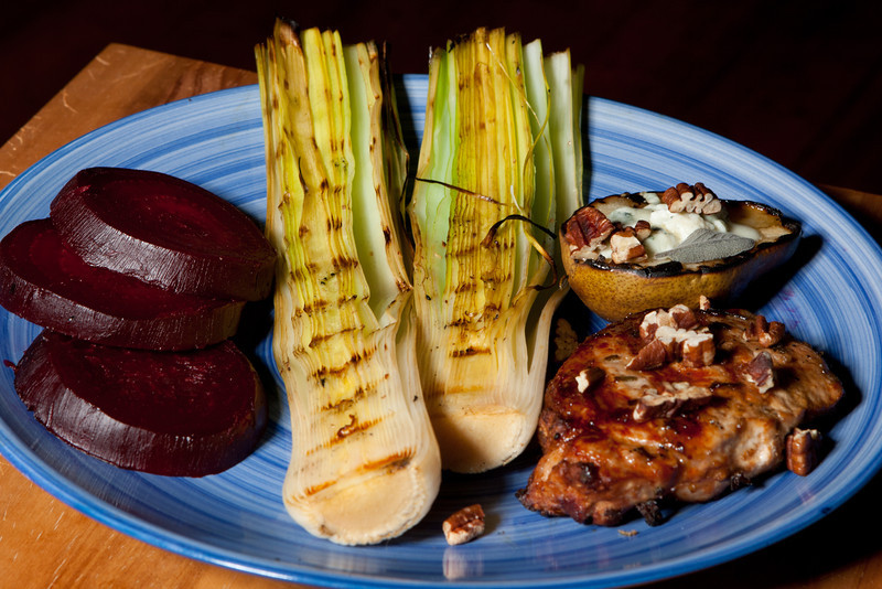 Pork chop, grilled pear with gorgonzola, pecans, grilled leeks, beets.