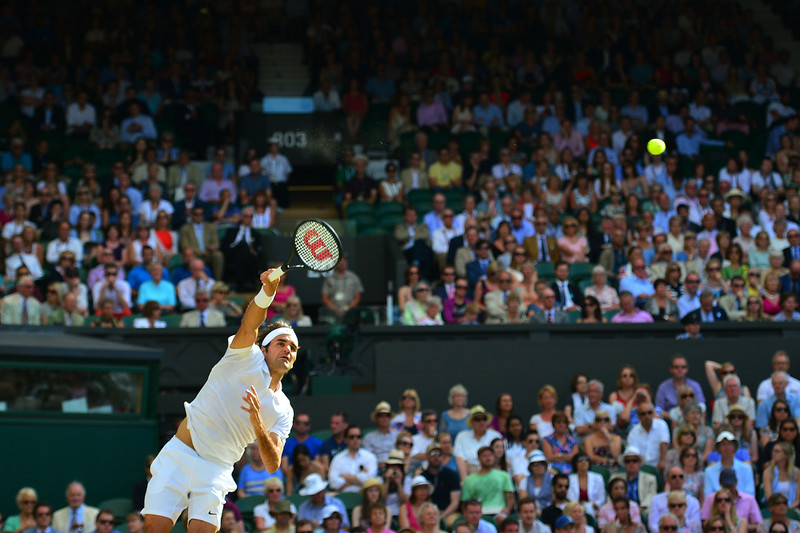 . Switzerland\'s Roger Federer serves to Canada\'s Milos Raonic during their men\'s singles semi-final match on day 11 of  the 2014 Wimbledon Championships at The All England Tennis Club in Wimbledon, southwest London, on July 4, 2014. (CARL COURT/AFP/Getty Images)