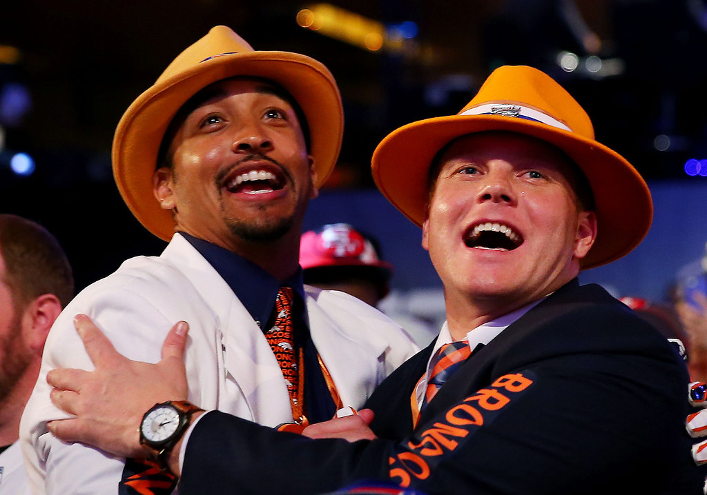 . Denver Broncos fans react during the first round of the 2014 NFL Draft at Radio City Music Hall on May 8, 2014 in New York City.  (Photo by Elsa/Getty Images)