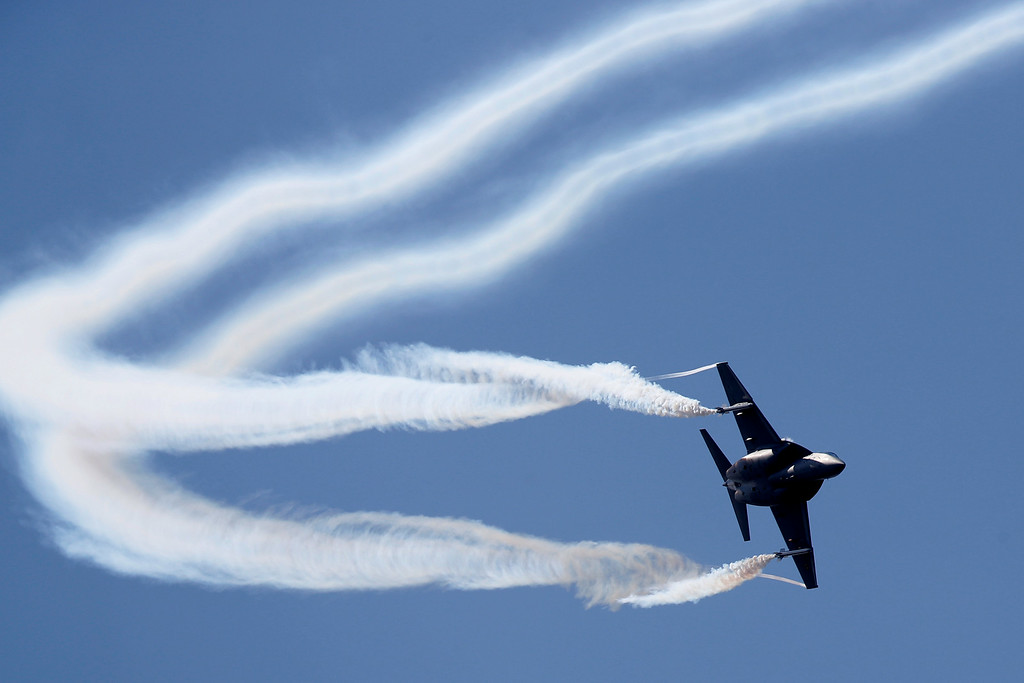 . An Alenia Aermacchi M346 flies on display during Farnborough International Air Show, Farnborough, England, Tuesday, July 15, 2014. (AP Photo/Sang Tan)