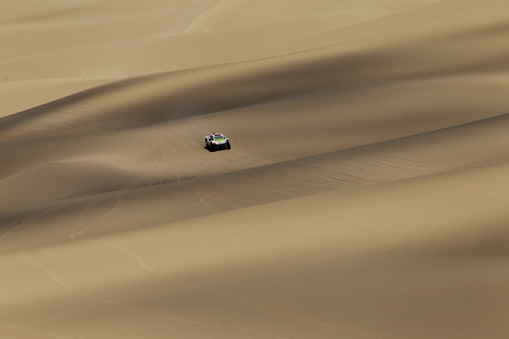. Ronan Chabot and co-driver Gilles Pillot, both of France, compete in the 3nd stage of the 2013 Dakar Rally from Pisco to Nazca, Peru, Monday, Jan. 7, 2013. The race finishes in Santiago, Chile, on Jan. 20. (AP Photo/Victor R. Caivano)