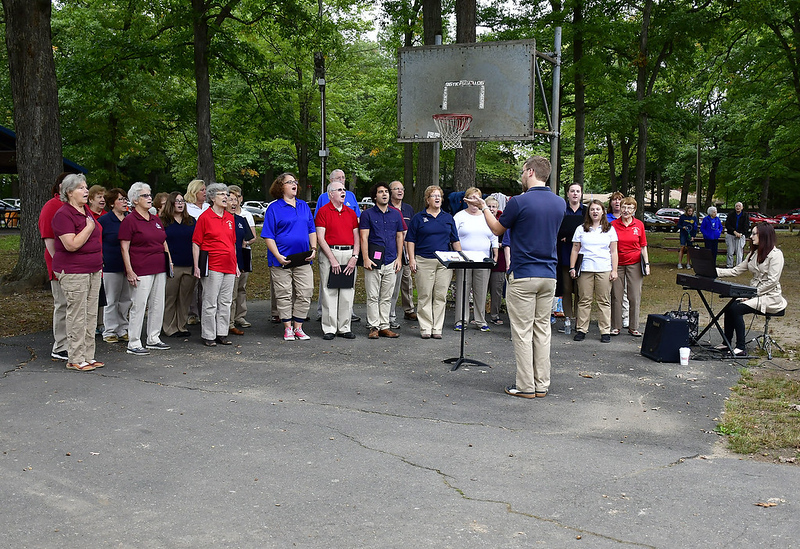 10/6/2018 Mike Orazzi | Staff Members of the Plainville Choral Society perform the Star Spangled Banner during the PARC annual walkathon at Norton Park Saturday morning.