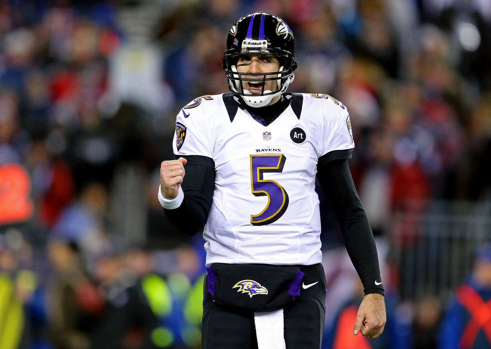 . Joe Flacco #5 of the Baltimore Ravens celebrates after a touchdown ran by Ray Rice #27 in the second quarter against the New England Patriots during the 2013 AFC Championship game at Gillette Stadium on January 20, 2013 in Foxboro, Massachusetts.  (Photo by Al Bello/Getty Images)