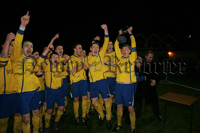 Newry AC Reserves Captain Stefan Martin holds the aloft the Wilmor Johnston Memorial Cup for his team. RS1414