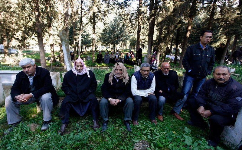 . People attend the funeral of Ali Sille, 26, one of the 13 victims who died during an explosion at a crossing on Turkey\'s border with Syria, in the town of Reyhanli on the Turkish-Syrian border in Hatay province February 12, 2013. A Syrian minibus exploded at a crossing on Turkey\'s border with Syria near the Turkish town of Reyhanli on Monday, killing at least 13 people including Turkish citizens and wounding dozens more, Turkish officials said. REUTERS/Umit Bektas