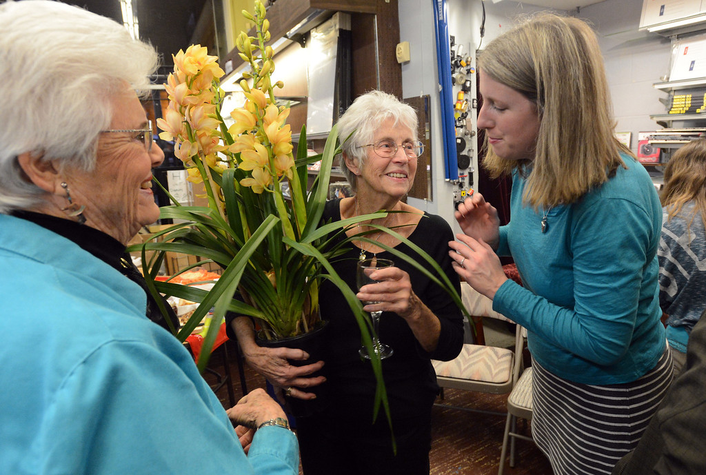 . Nancy Sarber, center, talks to Connie Sakrison, of Sonoma, left, and Jennifer Shaffer, of Oakland, during a farewell event for Sarber\'s Cameras in Oakland, Calif., on Friday, Feb. 1, 2013. The store was bought in 1961 by Peter and Nancy Sarber and moved to Montclair in 1964. After more than a half-century in business, Sarber\'s Cameras is closing. The Sarber family held the farewell event for longtime customers, friends and family in Montclair Village. (Doug Duran/Staff)