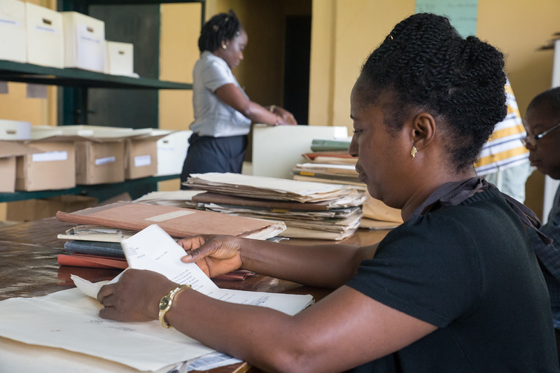 Monrovia, Liberia October 5, 2017 -  Workers at the National Archives patiently process paper files to digital.