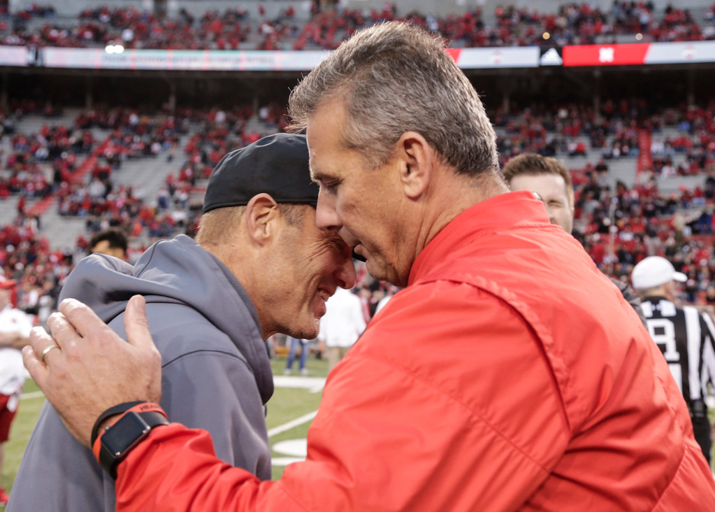 . Ohio State head coach Urban Meyer, right, and Nebraska head coach Mike Riley meet before an NCAA college football game in Lincoln, Neb., Saturday, Oct. 14, 2017. (AP Photo/Nati Harnik)