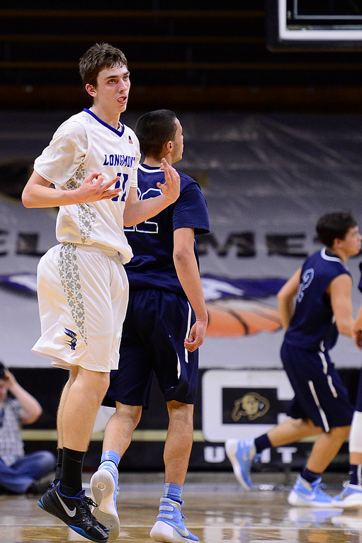 . David Speidel (11) of Longmont celebrates after hitting a three-point shot during the second quarter at the Coors Events Center on March 11, 2016 in Boulder, Colorado. Pueblo West defeated Vista Ridge 65-54 to advance to the 4A finals of Colorado state basketball tournament.  (Photo by Brent Lewis/The Denver Post)