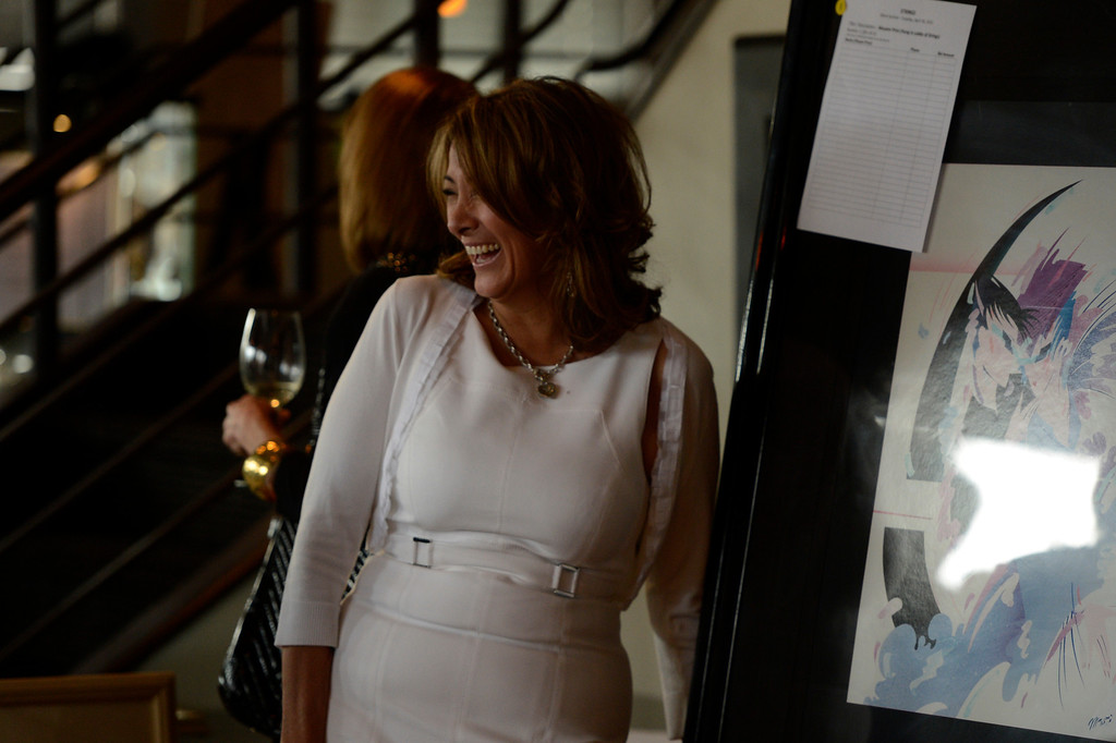 . DENVER, CO. - APRIL 30:  Tammy Cunningham, owner of Strings Restaurant near art work from the restaurant during the auction after the last day of service April 30, 2013 Denver, Colorado. (Photo By Joe Amon/The Denver Post)
