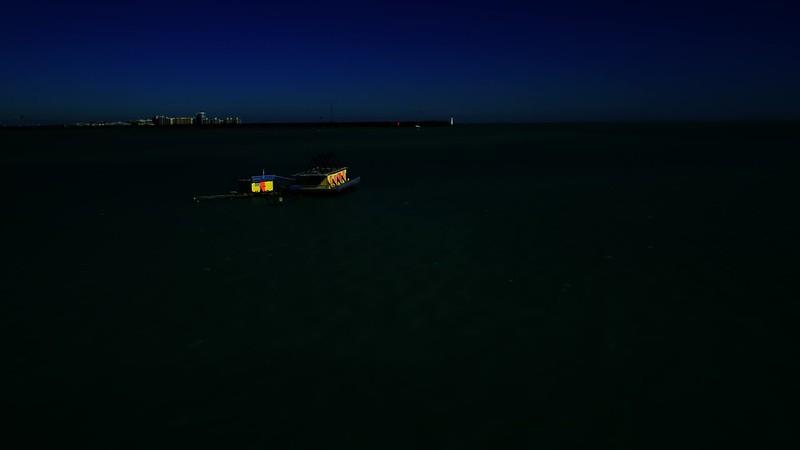Aerial night video house on stilts in the water Stiltsville Florida USA