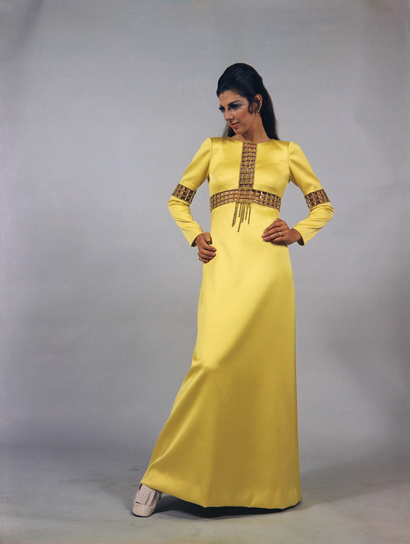 . Long Dress of Yellow craped silk, with Rhinestone trim by the Tiziani house of Rome for its fall and winter collection, July 18, 1968. The shoes are by Raphael of Rome. (AP Photo/Mario Torrisi)