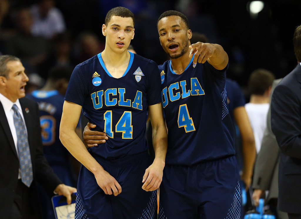 . Norman Powell #4 speaks with Zach LaVine #14 of the UCLA Bruins during a regional semifinal of the 2014 NCAA Men\'s Basketball Tournament against the Florida Gators at the FedExForum on March 27, 2014 in Memphis, Tennessee.  (Photo by Streeter Lecka/Getty Images)