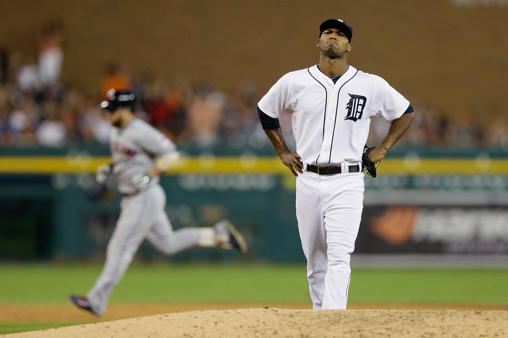 . Detroit Tigers relief pitcher Al Alburquerque reacts as Cleveland Indians\' Jason Kipnis rounds the bases after his three-run home run in the seventh inning of a baseball game in Detroit, Friday, July 18, 2014. (AP Photo/Carlos Osorio)