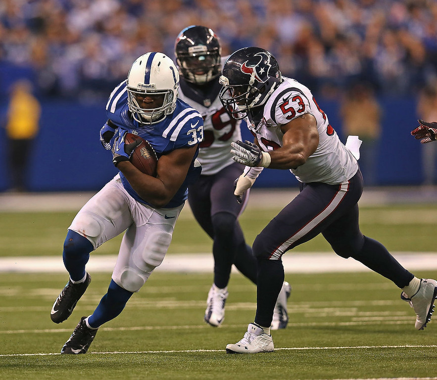 . Vick Ballard #33 of the Indianapolis Colts runs past Bradie James #53 of the Houston Texans at Lucas Oil Stadium on December 30, 2012 in Indianapolis, Indiana. The Colts defeated the Texans 28-16.  (Photo by Jonathan Daniel/Getty Images)