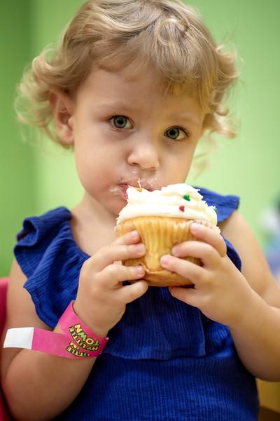 Ruby noshing cupcake.jpg