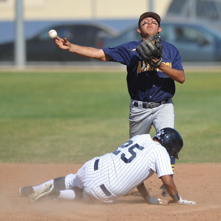 . Alhambra second baseman Andrew Arroyo (#4) forces out Montebello\'s Chris Gonzales (#25) but fails to complete the double play in their Almont League baseball game at Montebello High School in Montebello  on Friday April 19, 2013. (SGVN/Staff Photo by Keith Durflinger)
