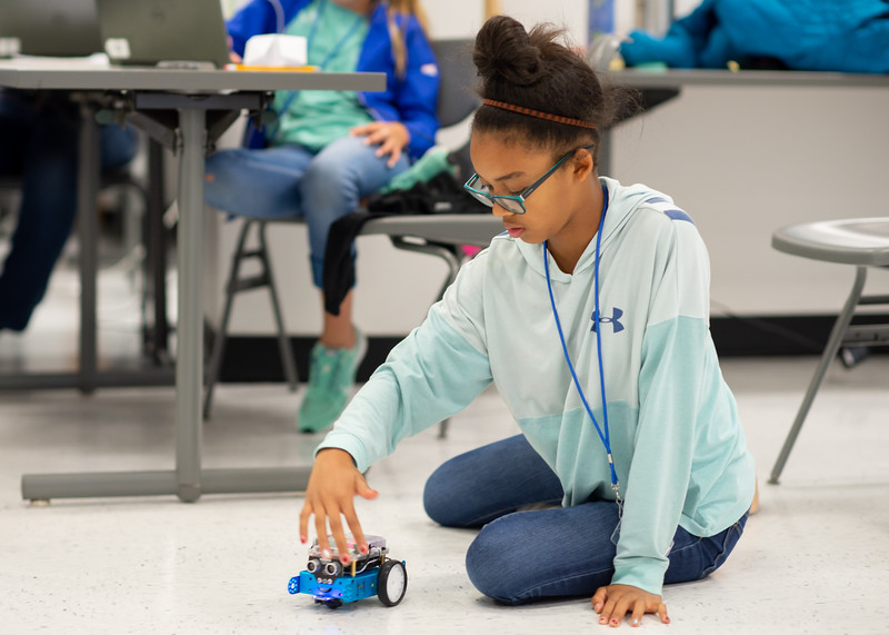 Libby Campbell tests out the visual sensors on her mBot during the Girls Code Camp.  Check out other summer camps available for kids and teens: http://bit.ly/2MighNt