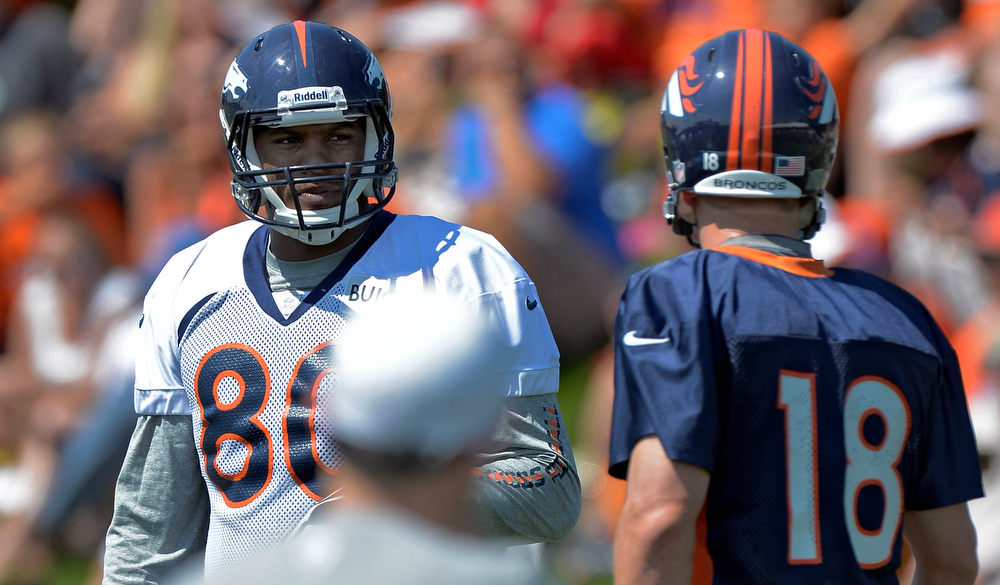 . Denver Broncos TE Julius Thomas (80) talks with QB Peyton Manning (18) during training camp July 26, 2013 at Dove Valley. (Photo By John Leyba/The Denver Post)