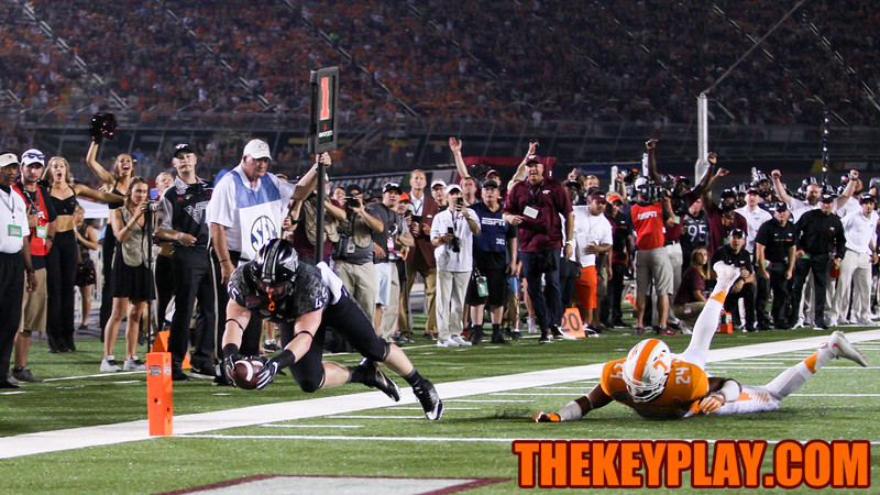 RB Sam Rogers leaps for the pylon to score the first touchdown of the game for Virginia Tech. (Mark Umansky/TheKeyPlay.com)