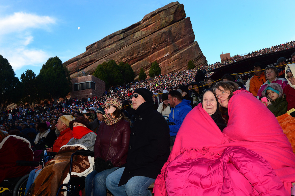 """. Arlene Wiberg, middle, and her daughter Theresa Wiberg, right, stay warm under lots of blankets as the two enjoy  the 67th annual Easter sunrise service  at Red Rocks Amphitheater in Morrison, Colorado, on April 17, 2014.  Superintendent Patrick L. Demmer gave the sermon which was entitled \""""What are you looking for?\"""".  The popular annual event, which hosts thousands of worshipers, is sponsored by the Colorado Council of Churches.  (Photo By Helen H. Richardson/ The Denver Post)"""