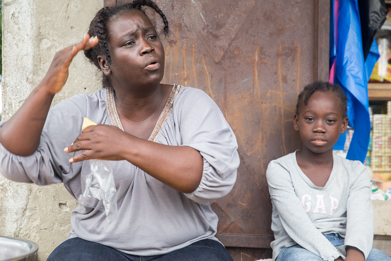 Monrovia, Liberia October 6, 2017 - Jacqueline Clinton,  a student in the REVSLA program who owns her own general store, sits with her daughter.