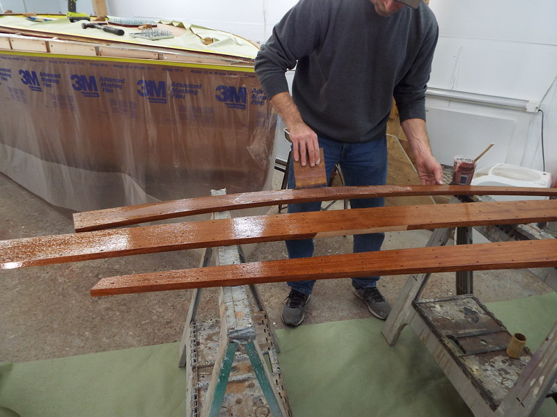 Applying epoxy to the new cover boards.