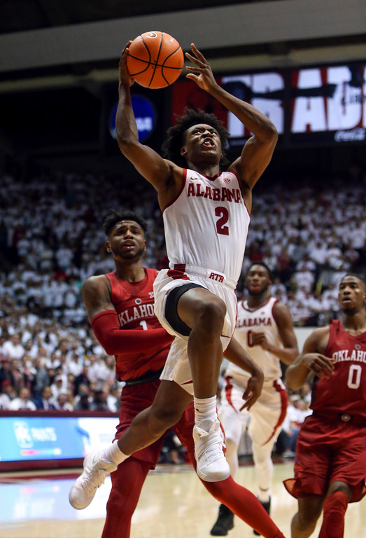 . Alabama guard Collin Sexton (2) drives to the basket for a layup against Oklahoma during the second half of an NCAA college basketball game, Saturday, Jan. 27, 2018, in Tuscaloosa, Ala. (AP Photo/Butch Dill)
