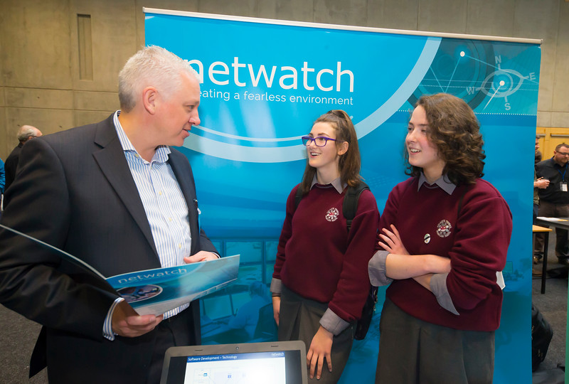 "09/11/2017. Crystal Valley Tech Showcase at WIT Arena. Pictured are Alex Sheehan and Sophie Lye, students from St Declan's Secondary School with Declan Mcgrane of Netwatch. Picture: Patrick Browne  Event demonstrates Tech and ICT is thriving in Waterford and the South East 50 companies and 2,000 students, industry and recruiters attend the inaugural Crystal Valley Tech Showcase event  Over 50 companies who are working together as Crystal Valley Tech showcased their rapidly growing industry in the WIT Arena on Thursday morning to approx. 2,000 members of the public, college and second level students, recruiters, government agencies and other industry.  The future is bright for ICT in the South East according to Dr Padraig Kirwan, Head of the Department of Computing & Mathematics at Waterford Institute of Technology. ""Computing is thriving in the South East judging by the number and diversity of ICT companies here today. Even more encouraging is the number of second level students who attended from Waterford, Kilkenny, Carlow, Tipperary and Wexford and how interested they are about the career opportunities in this exciting industry.""  Waterford schools attending the event included the Presentation Secondary School, St Angela's Secondary School, St Paul's Community College, and the Waterford College of Further Education from Water city, St Declan's Community College in Kilmacthomas, and Colaiste Chathail Naofa in Dungarvan.  Elaine Fennelly, Bluefin Payment Systems General Manager and co-founder of Crystal Valley Tech is very excited about the industry in the South East and today's showcase event. ""People who work in the industry already know that Tech is well established in the South East and the number of opportunities and companies continues to grow and grow. According to a recent Tech Ireland report there are over 60 indigenous and multinational companies employing well over 1,500 people from their bases in Waterford, Wexford, Kilkenny and Carlow.  �"