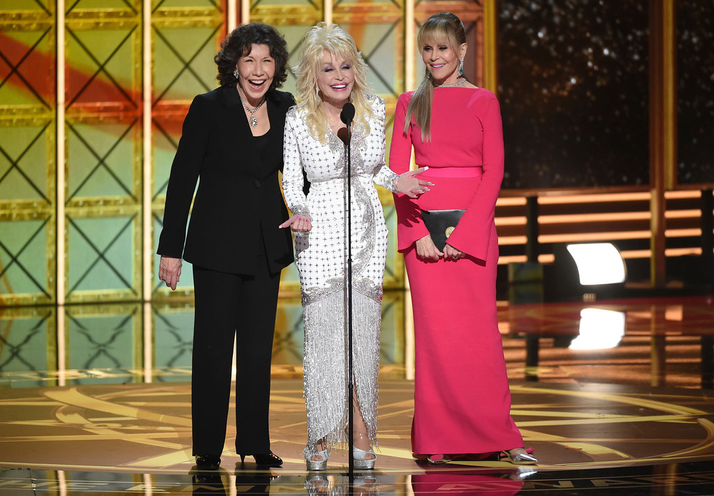 . Lily Tomlin, from left, Dolly Parton, Jane Fonda speak at the 69th Primetime Emmy Awards on Sunday, Sept. 17, 2017, at the Microsoft Theater in Los Angeles. (Photo by Phil McCarten/Invision for the Television Academy/AP Images)