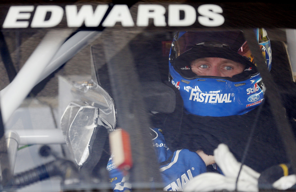 . DAYTONA BEACH, FL - FEBRUARY 20:  Carl Edwards, driver of the #99 Fastenal Ford, sits in his car in the garage area during practice for the NASCAR Sprint Cup Series Daytona 500 at Daytona International Speedway on February 20, 2013 in Daytona Beach, Florida.  (Photo by Sam Greenwood/Getty Images)