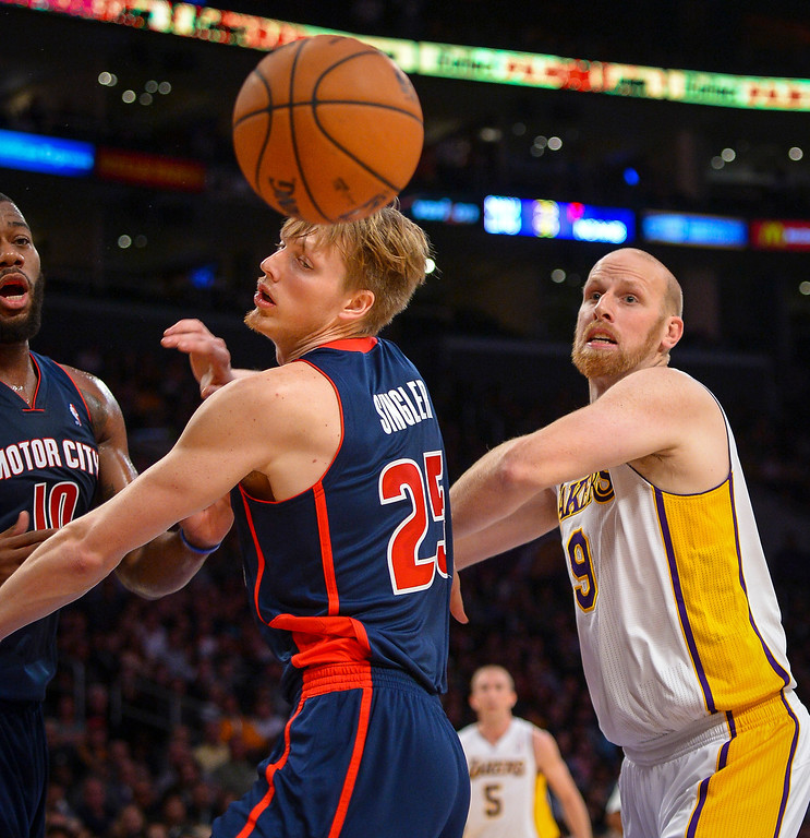 . Lakers� Chris Kaman and Detroit�s Kyle Singler lose a loose ball during first half action at Staples Center Sunday, November 17, 2013.  ( Photo by David Crane/Los Angeles Daily News )