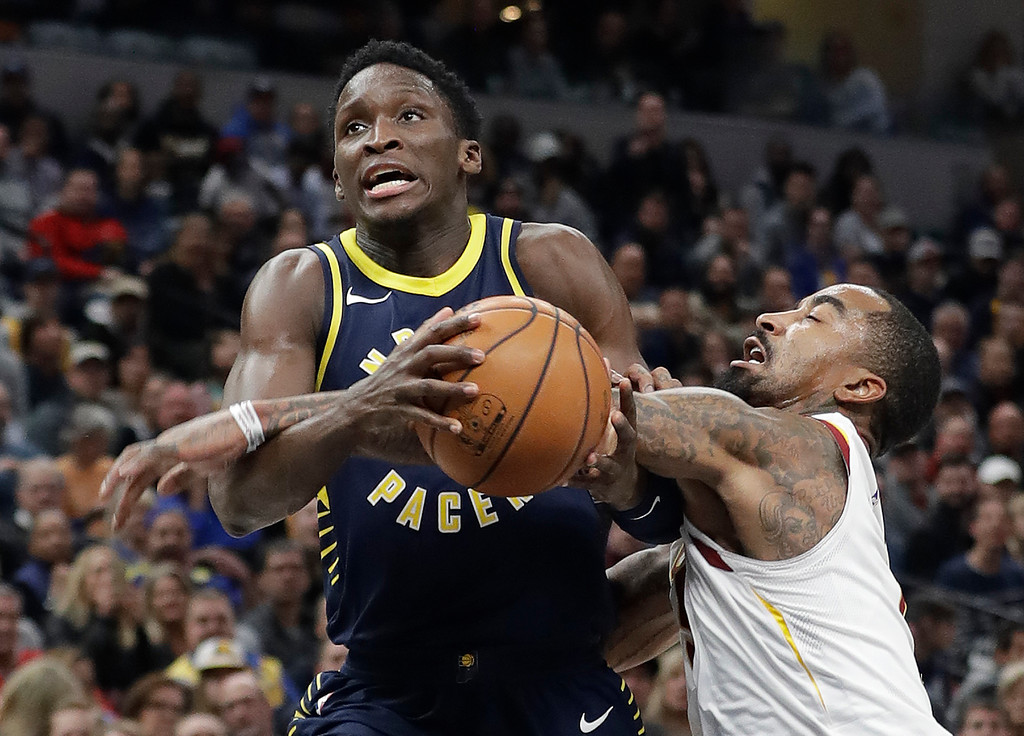. Indiana Pacers\' Victor Oladipo (4) is fouled by Cleveland Cavaliers\' JR Smith during the second half of an NBA basketball game Friday, Dec. 8, 2017, in Indianapolis. The Pacers won 106-102. (AP Photo/Darron Cummings)