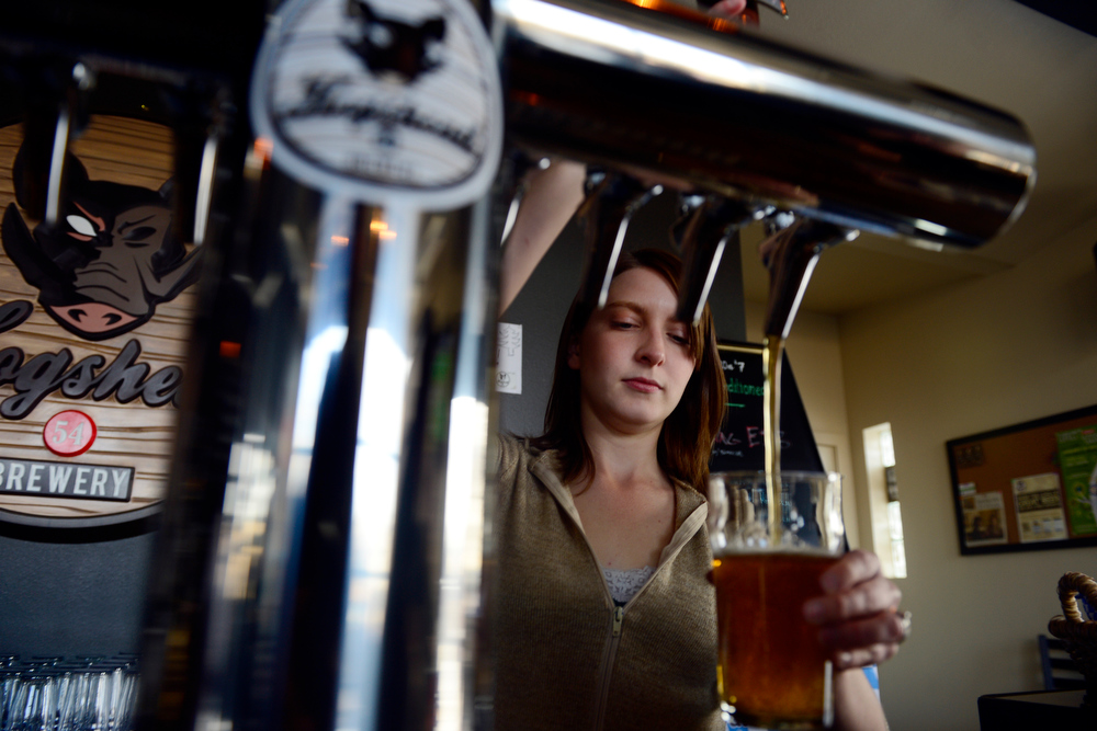 . Heather Hedberg pours a pint of Lake Lightening at Hogshead Brewery in Denver on Sunday, January 6, 2013. AAron Ontiveroz, The Denver Post
