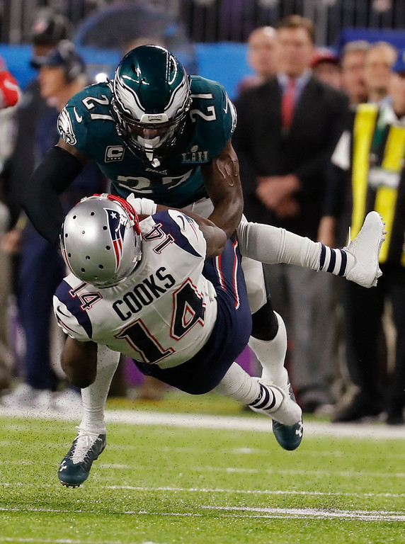 . New England Patriots wide receiver Brandin Cooks (14) collides with Philadelphia Eagles strong safety Malcolm Jenkins (27), during the first half of the NFL Super Bowl 52 football game, Sunday, Feb. 4, 2018, in Minneapolis. (AP Photo/Charlie Neibergall)