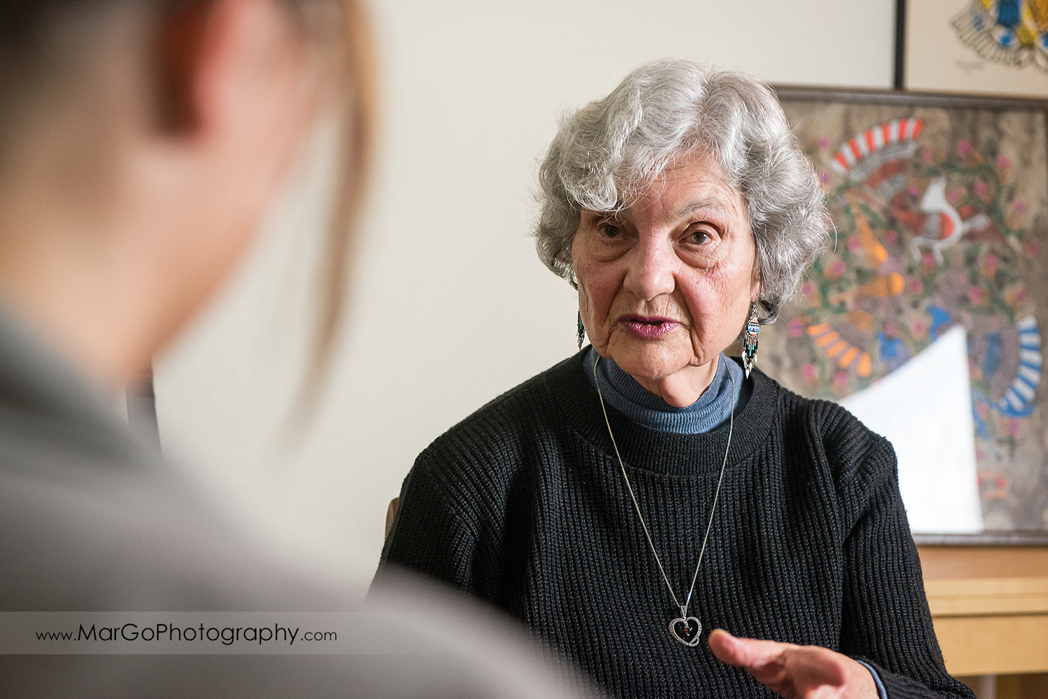 portrait of old Jewish woman interviewed at her home