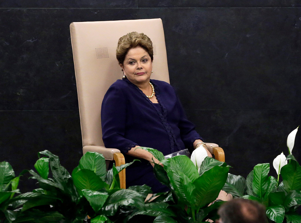 """. In this Tuesday, Sept. 24, 2013 photo, Brazil\'s President Dilma Rousseff waits to be introduced to address the 68th session of the United Nations General Assembly, in New York. Rousseff accused the U.S. of violating Brazil\'s sovereignty with what she called a \""""grave violation of human rights and of civil liberties\"""" regarding the U.S. National Security Agency surveillance program that has swept up data from telephone calls and emails that have passed through Brazil, including her own. (AP Photo/Richard Drew)"""