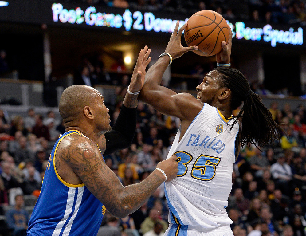 . DENVER, CO - APRIL 16: Denver Nuggets forward Kenneth Faried (35) gets his jersey pulled by Golden State Warriors forward Marreese Speights (5) as he goes up for a shot during the first quarter April 16, 2014 at Pepsi Center. (Photo by John Leyba/The Denver Post)