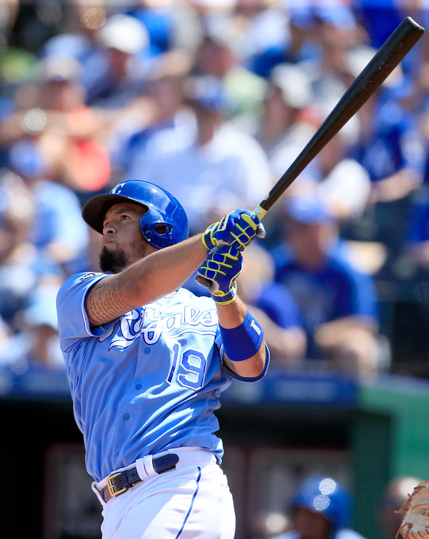 . Kansas City Royals\' Cheslor Cuthbert hits a two-run single during the fifth inning of a baseball game against the Cleveland Indians at Kauffman Stadium in Kansas City, Mo., Sunday, Aug. 20, 2017. (AP Photo/Orlin Wagner)