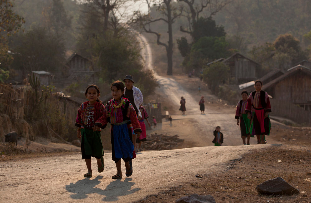 . Ethnic Lisu girls and women dressed in traditional clothing walk down a road in Thon Min Yar village, central Shan state, Myanmar on Feb 20, 2013. Far from Myanmar\'s postcard-perfect pagodas and colonial relics, the remote mountain villages of southern Shan State do not appear on maps of Myanmar or in any guide books. In obscurity, they have been ground zero for Myanmar\'s drug trade which has thrived on poverty and corruption. (AP Photo/Gemunu Amarasinghe)