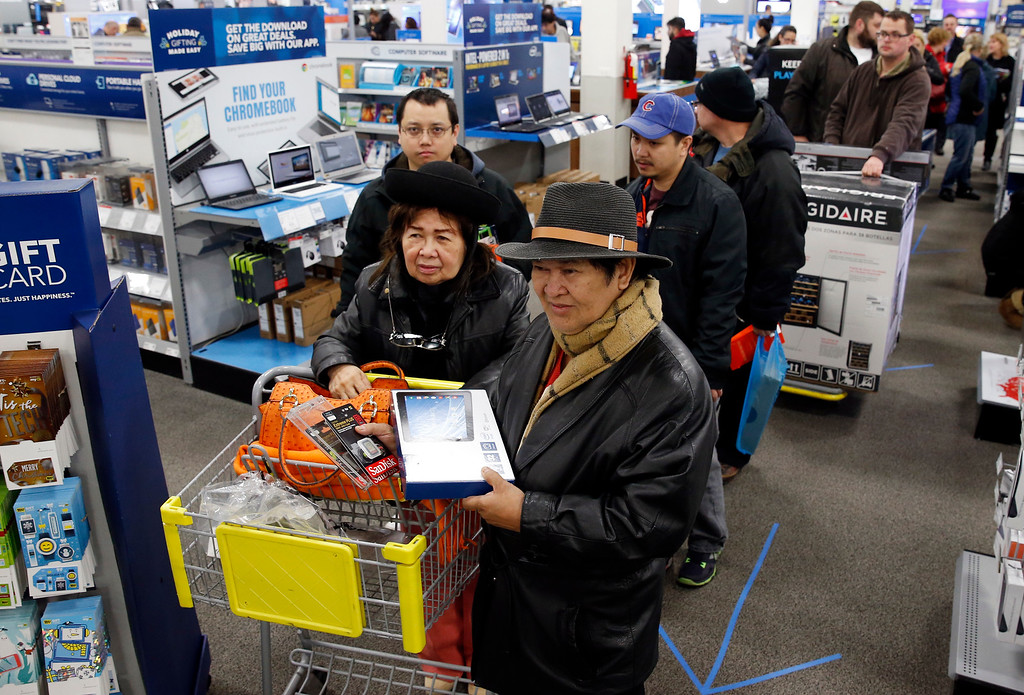 . Shoppers line up for purchases at a Best Buy store on Friday, Nov. 25, 2016, in Skokie, Ill. Black Friday, historically the starting line of the retail industry\'s crucial holiday buying season, isn\'t quite the one-day spree it used to be. Some retailers have pushed their biggest Black Friday door-buster deals into Thanksgiving Day and spread other promotions to even earlier in the season. (AP Photo/Nam Y. Huh)