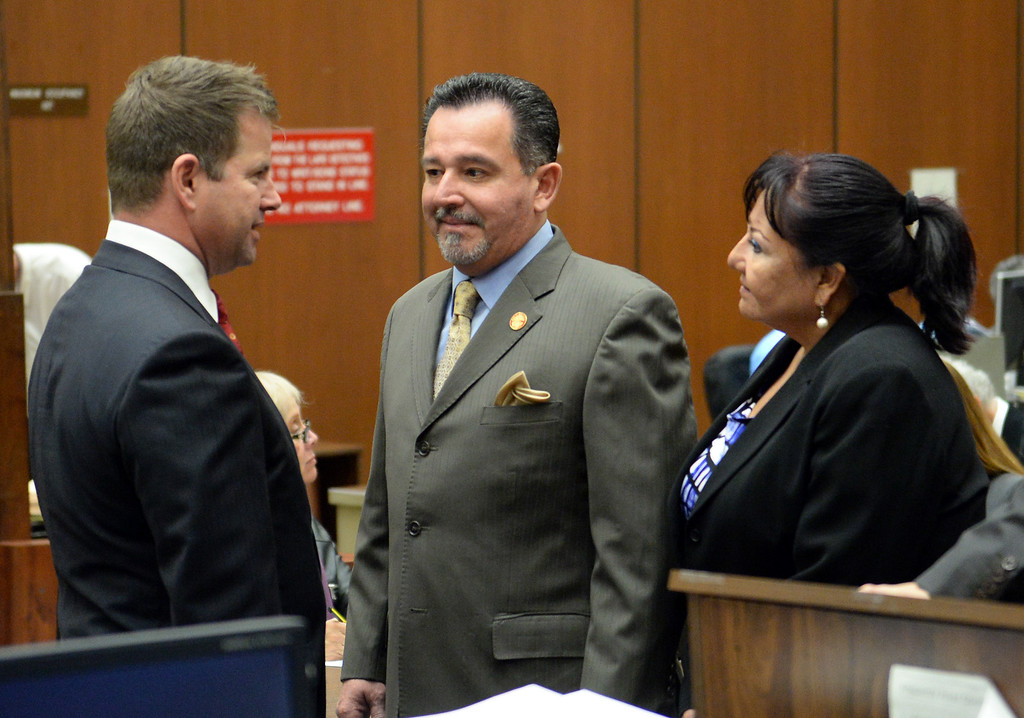 . Irwindale City Councilman Mark Breceda, center, and former City Councilwoman Rosemary Ramirez who have been charged with embezzlement, misappropriation of public funds and conflict of interest, talk with attorney Anthony Falangetti, left, as they appear in court to postpone their arraignment at the Clara Shortridge Foltz Criminal Justice Center in Los Angeles on Wednesday January 29, 2014. They will next appear on February 27th. (Staff Photo by Keith Durflinger/San Gabriel Valley Tribune)