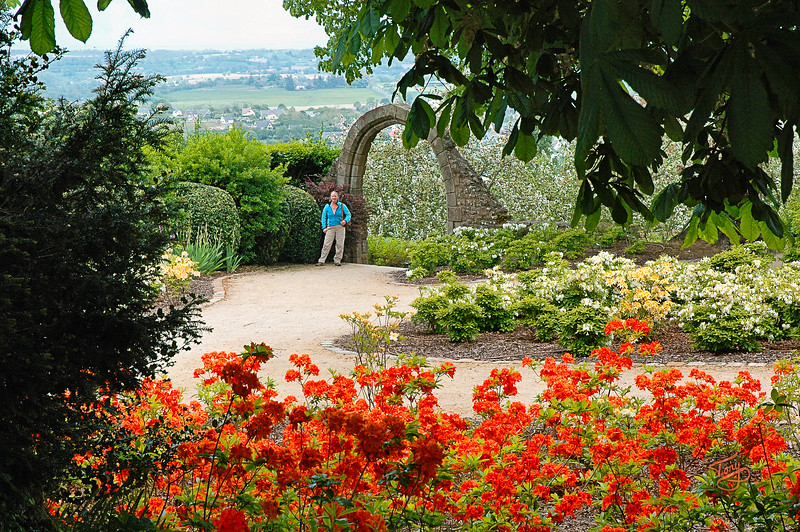 Avranches - 2009 - Le Jardin-des-Plantes - Judy by the arch.  The Jardin received a major overhaul in 2007.  I don't find it quite as charming as I did, but this spot is still beautiful.